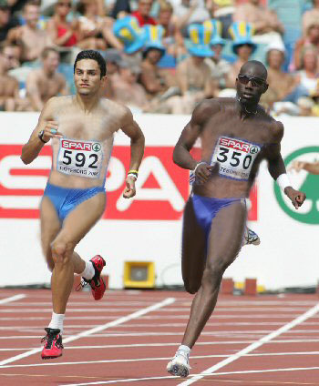Two men sprinters have been photoshopped to make their uniforms look like the women's uniforms