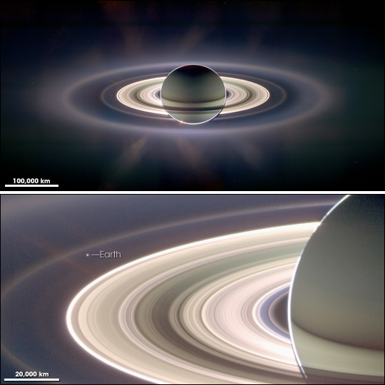 Saturn and its rings - photo taken by Cassini spacecraft - the pale blue dot of earth can be faintly perceived through the outermost rings