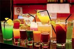 an array of drinks on a bar