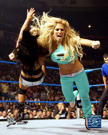 A poster picture of Wrestling Diva Torrie Wilson about to slam another wrestler to the mat - we see Torrie in full face but only see the back of the other wrestler's head and foreshortened torso as she levels off to horizontal