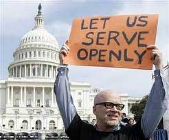 A man holding a sign outside the US Capitol building, sign reads *Let Us Serve Openly*