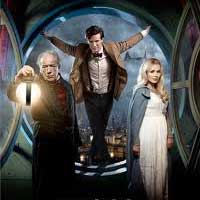 BBC promo shot showing Matt Smith as The Doctor standing in a large oval window, with an old man holding a lantern and a young woman wearing a cloak