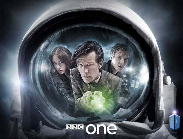 A astronaut's face mask reflects Amy, The Doctor and Rory looking anxious - The Doctor is holding his sonic screwdriver out, activated