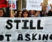 "Women marching behind a ""Still not Asking for 'It'"" sign at Slutwalk Manchester"