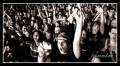 Black and white photograph of a rock festival audience crowd