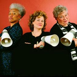 L-R: Gaye Adegbalola, Andra Faye,  Ann Rabson all holding megaphones