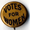 a badge or button displaying the words VOTES FOR WOMEN