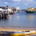 A ferry approaches Manly Wharf, as seen from the harbour beach