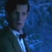The Doctor, in bowtie and tweed, in a wintry forest at night. He looks concerned.