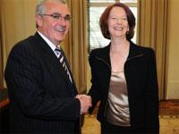 Andrew Wilkie shakes hands with Julia Gillard