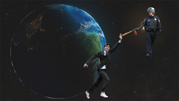 The Earth spins in space; approaching it is a policeman in riot gear spraying pepper spray; between him and the Earth stands the 10th Doctor with had upraised protectively