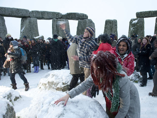 A snowball fight marks the 2010 winter solstice at Stonehenge on Salisbury plain in southern England December 22, 2010