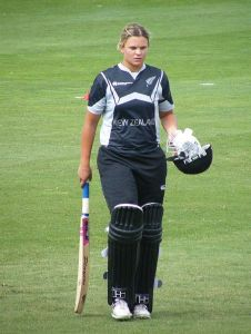 Suzie Bates stands with bat in the field
