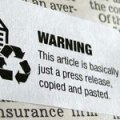 "image of a sticker over newsprint: sticker reads ""WARNING This article is basically just a press release, copied and pasted."""