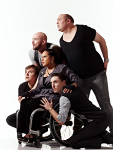 The cast of Outland -- four apparently white men and a black woman using a wheelchair, looking off into the distance.