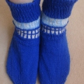 TARDIS socks. They are dark blue with white windows and light blue panelling with white writing on it that says Police Box.