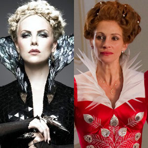 Two evil queens side by side: Charlize Theron steely in black, Julia Roberts envious in red