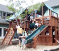 Kids on a playground surrounded by houses