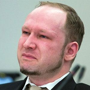 Anders Breivik listens to proceedings in court
