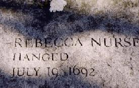 "Granite slab with the carved text ""Rebecca Nurse, hanged, July 19 1692"