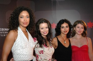 The four female actors from Firefly in evening dress