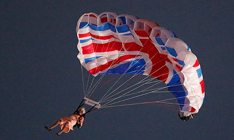 A stunt performer dressed as Queen Elizabeth II parachutes into the Olympic Stadium for the Opening Ceremony