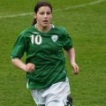 Taylor running, in Irish soccer kit