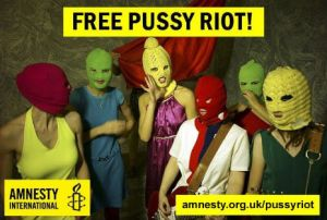 "The eight members of Pussy Riot, wearing brightly coloured balaclavas, with the caption ""Free Pussy Riot"", and the Amnesty International logo."