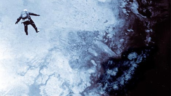 Photo taken from helium gondola which carried Kittinger through the atmosphere: Kittinger is well below the camera in his pressurised suit, falling towards the outline of landmasses below