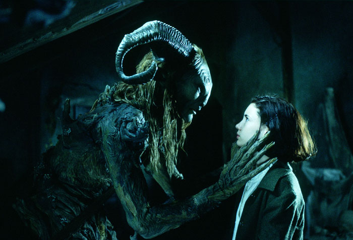 Still from Pan's Labyrinth. The faun talks to Ophelia, with his hand on her face.