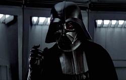 Darth Vader gestures menacingly in the first Star Wars movie