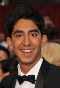 publicity headshot of Dev Patel, a young man of South Asian appearance