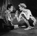 B&W photo of Vanessa Redgrave in cutoff pants and cloth cap, playing Rosalind, with her Orlando.