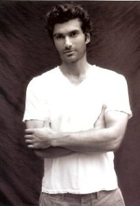 publicity headshot of Sendhil Ramamurthy, a young man of South Asian appearance
