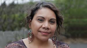 Headshot of Deborah Mailman with a background of bush