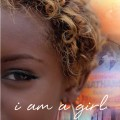 "quarter face of black teenage girl with the inscription ""i am a girl""."