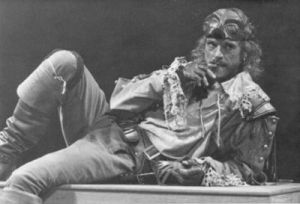 B&W photo of Jeremy Irons lying on his side, in cavalier costume.