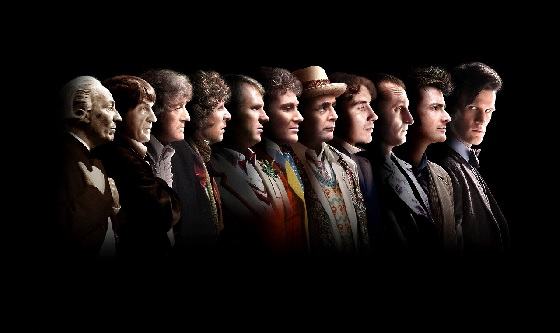 eleven doctors from #1 on left to #11 on right - the first 10 doctors are looking towards #11, who is looking into the camera