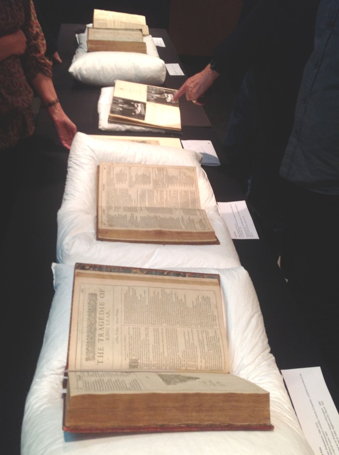 Four of Shakespeare's original folios laid in a line.
