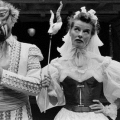 B&W of Kate Hepburn in very silly costume, with a goat mask on a stick.