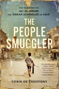 Front cover page of The People Smuggler. Seen from the back a young boy holding a stick runs along with a tyre rolling in front of him, down a wide dusty street with traffic on either side flanked by tall houses and shops.