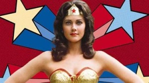 Lynda Carter in WW costume, background of drawn shooting stars.