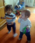 Two toddlers walking