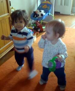 Two toddlers walking