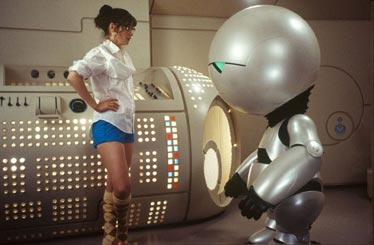 Movie still of Trillian and a round-headed robot.