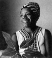 B&W of Maya Angelou as a young woman, in traditional African dress.