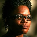 Head portrait of black woman with glasses.