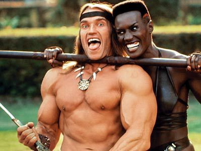 Arnold Schwarzenegger and Grace Jones fooling around with sharp pointy things on the set of Conan The Destroyer