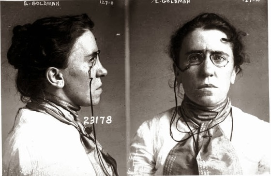 B&W police profile & full face of woman in Victorian blouse and glasses.