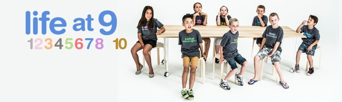 8 children around a long table. Text: Life at 9